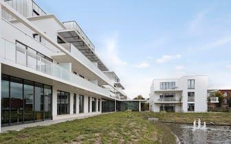 Het nieuwbouwproject 'Witte Molen Park', gelegen aan de rand van Brugge op de hoek van Koning Albert...